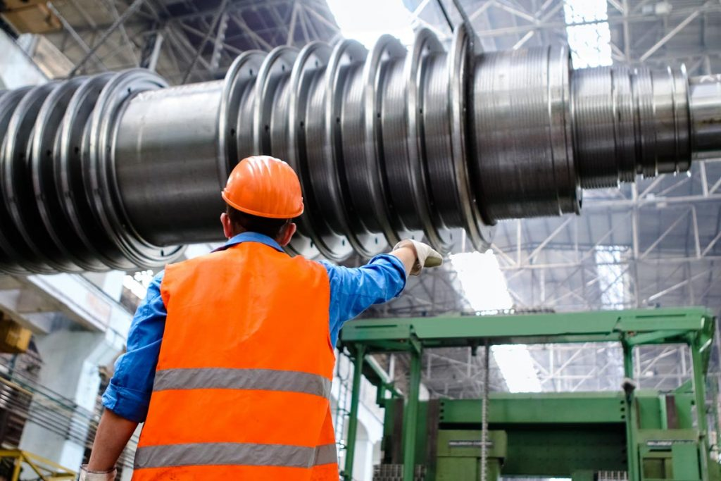 Back of an engineer pointing a large accelerator